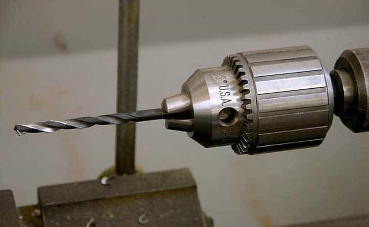 A drill press chuck holding a drill bit